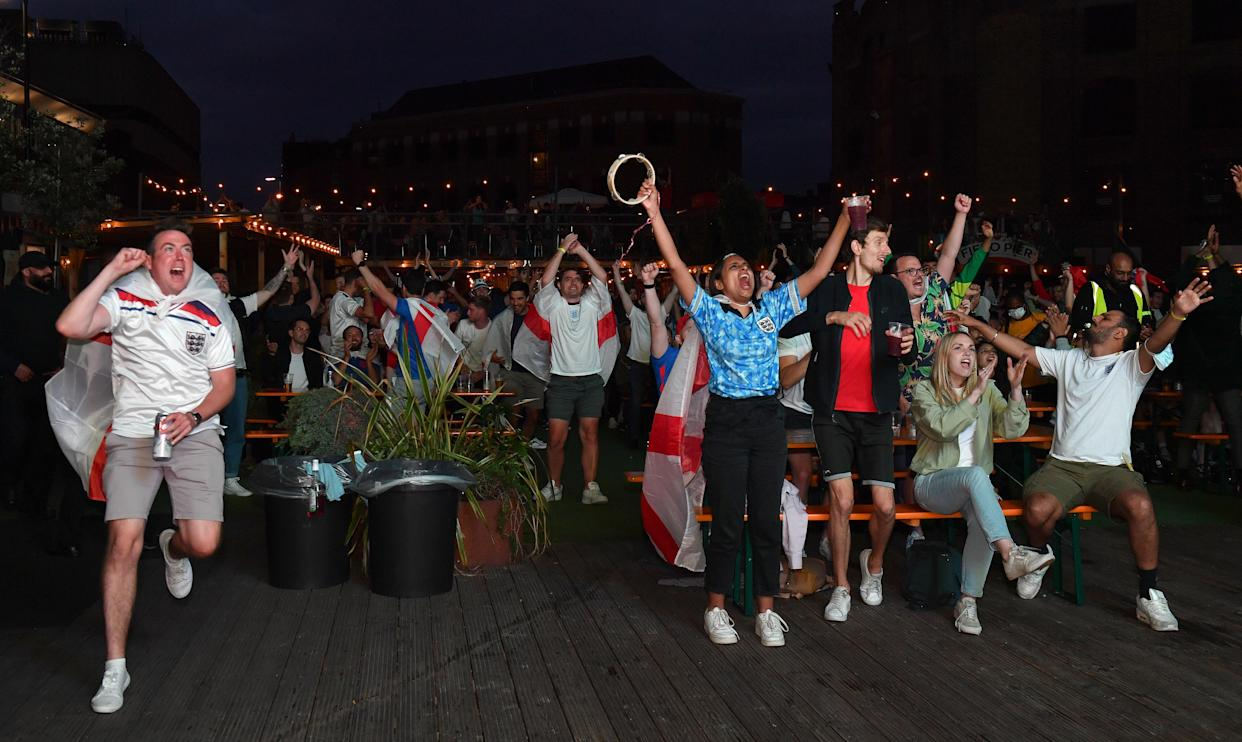 Fans at the Vinegar Yard in London celebrate at the end of the game after watching the Euro 2020 quarter final match between England and the Ukraine. Picture date: Saturday July 3, 2021.