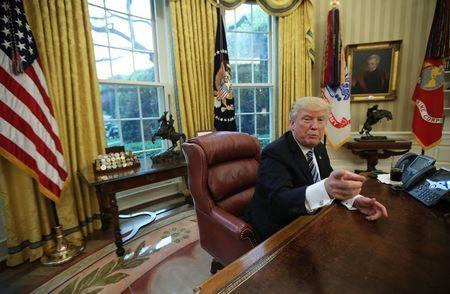 U.S. President Donald Trump speaks during an interview with Reuters in the Oval Office of the White House in Washington, U.S., April 27, 2017. REUTERS/Carlos Barria