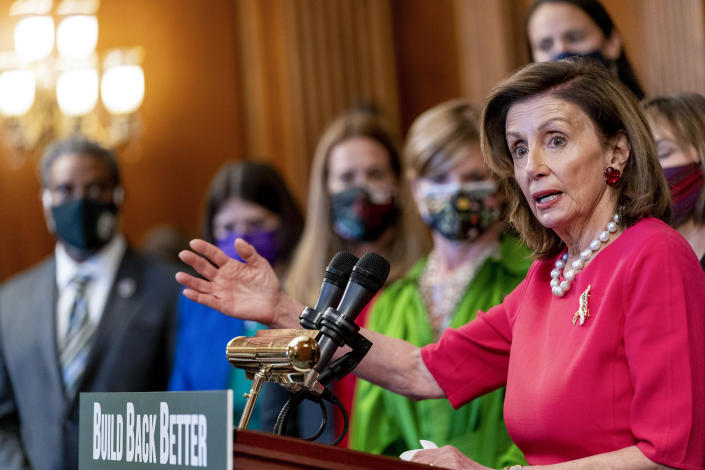 House Speaker Nancy Pelosi of Calif., accompanied by other House democrats and climate activists, pauses while speaking about their Build Back Better on Climate plan on Capitol Hill in Washington on Sept. 28, 2021. (Andrew Harnik/AP)
