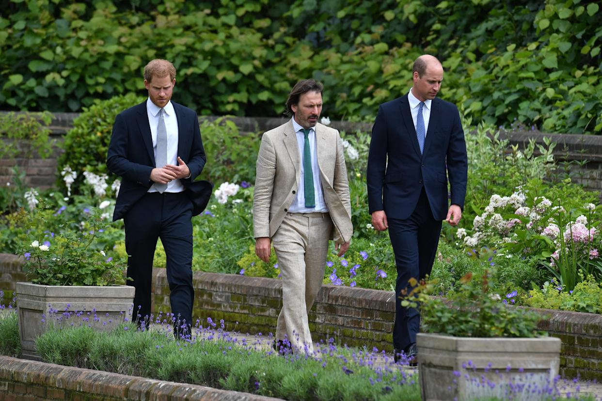 The Duke of Sussex (left), the Duke of Cambridge (right) and garden designer Pip Morrison, arrive for the unveiling of a statue they commissioned of the Dukes' mother Diana, Princess of Wales, in the Sunken Garden at Kensington Palace, London, on what would have been her 60th birthday. Picture date: Thursday July 1, 2021.