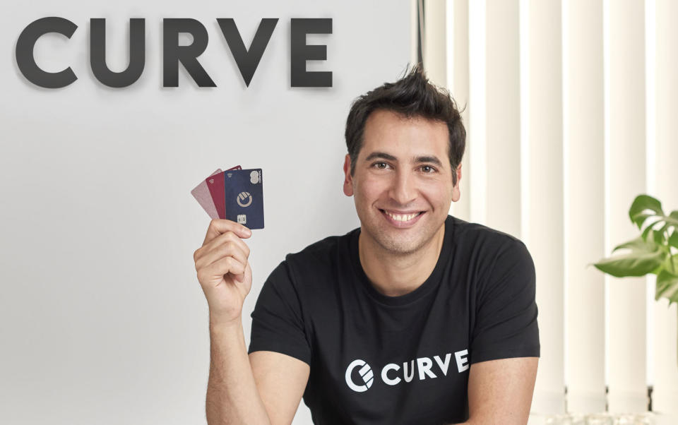 Curve CEO and founder Shachar Bialick with his company's cards. Photo: Curve