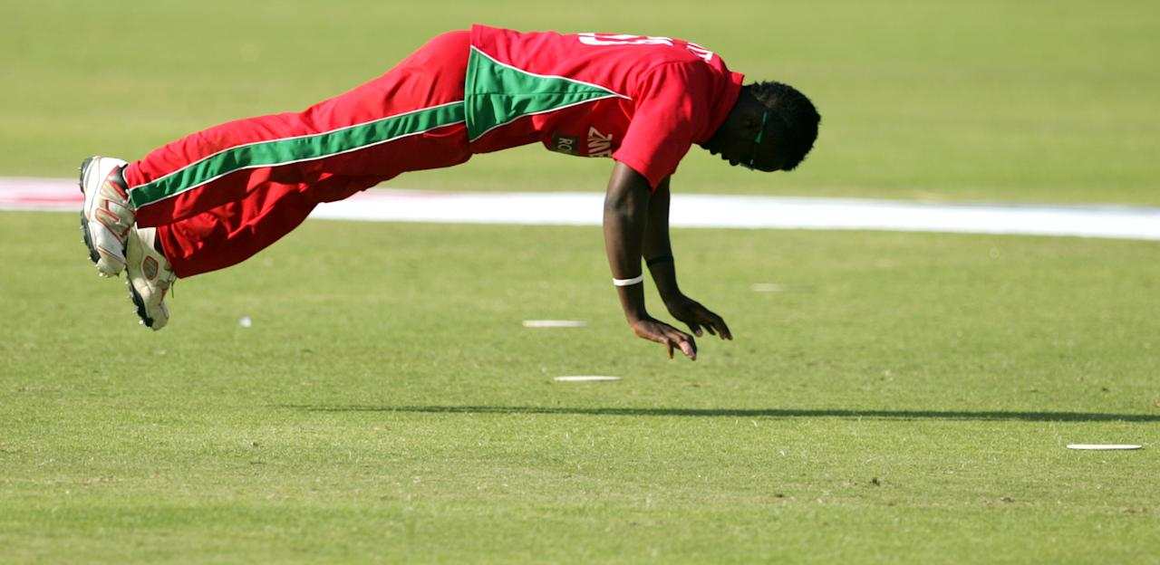 Zimbabwe's bowler Brian Vitori limbers up before a bowling spell during the 3rd match of the 5 cricket ODI series between Zimbabwe and India at Harare Sports Club on July 28, 2013. AFP PHOTO / JEKESAI NJIKIZANA        (Photo credit should read JEKESAI NJIKIZANA/AFP/Getty Images)