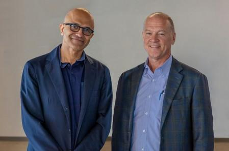 Handout photo of Satya Nadella, CEO, Microsoft Corporation and John Donovan, CEO, AT&T Communications pose in Redmond, Washington