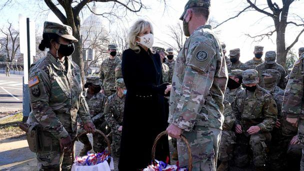 PHOTO: First lady Jill Biden surprises National Guard members outside the Capitol with chocolate chip cookies, Jan. 22, 2021 (Jacquelyn Martin/Poo/AP)