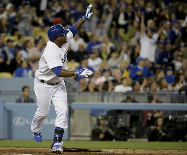 Los Angeles Dodgers' Juan Uribe celebrates his game tying home run against the Arizona Diamondbacks during the ninth inning of a baseball game in Los Angeles, Friday, April 18, 2014. (AP Photo/Chris Carlson)