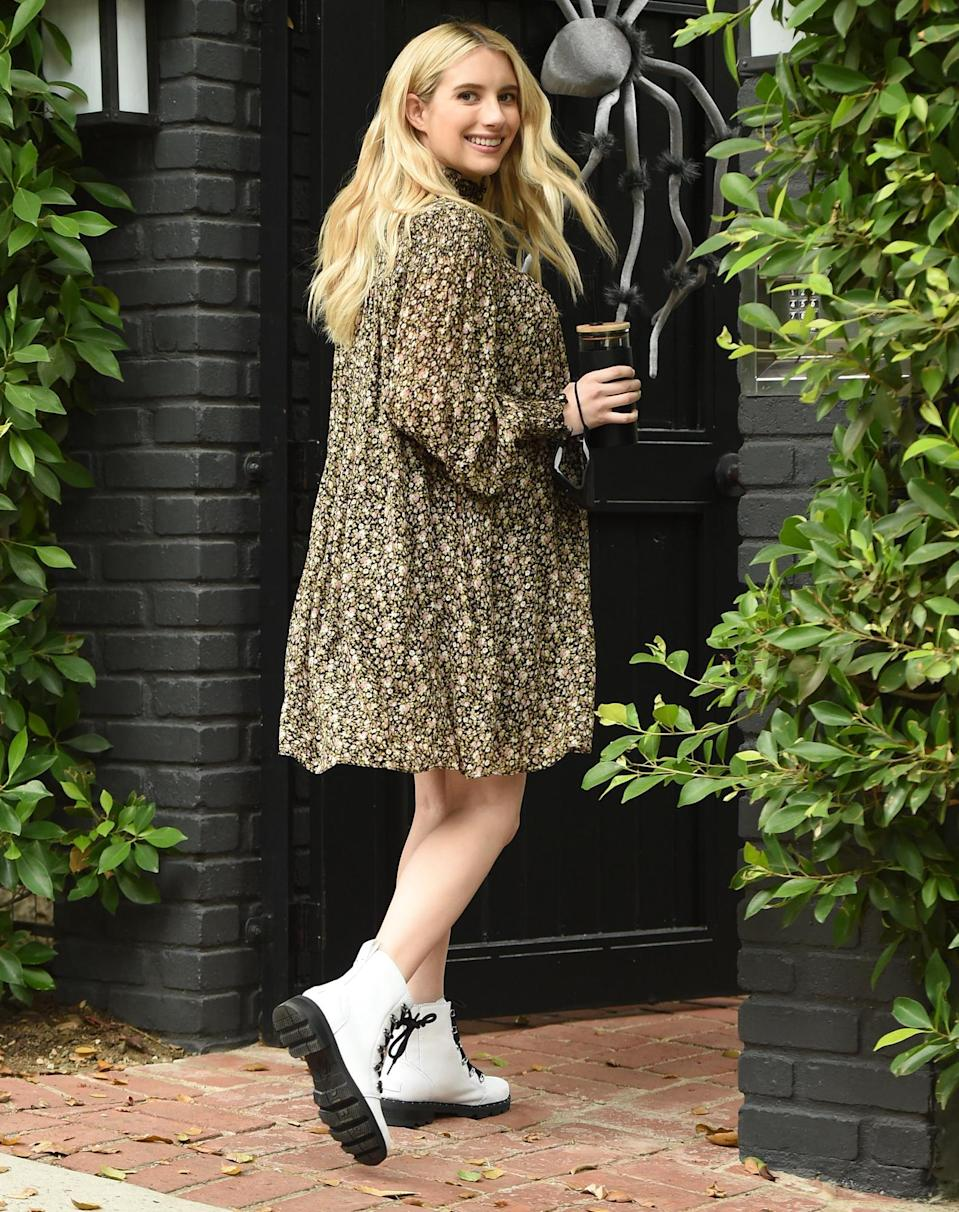 <p>Emma Roberts flashes a smile while out in L.A. on Friday, wearing a babydoll dress and Sorel boots.</p>