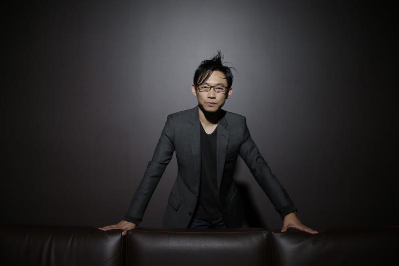 "In this Monday, June 17, 2013 photo, Malaysian-Australian director James Wan poses for photos at the Paramount Pictures Studios in Los Angeles. Wan has been splitting his days this summer between pre-production on the seventh ""Fast & Furious"" film and putting the finishing touches on his indie scare-fest ""Insidious 2,"" due in September. (AP Photo/Jae C. Hong)"