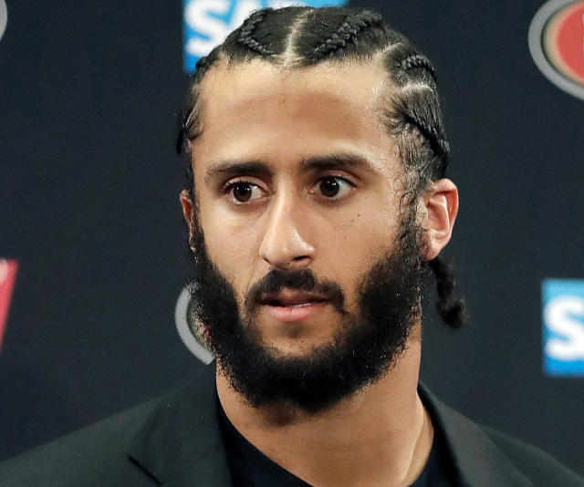 FILE - This Jan. 1, 2017, file photo shows then San Francisco 49ers quarterback Colin Kaepernick speaking at a news conference after the team's NFL football game against the Seattle Seahawks in Santa Clara, Calif. Kaepernick is among eight recipients who will honored by Harvard University with the W. E. B. Du Bois Medal during a ceremony on Oct. 11, for contributions to black history and culture. (AP Photo/Marcio Jose Sanchez, File)