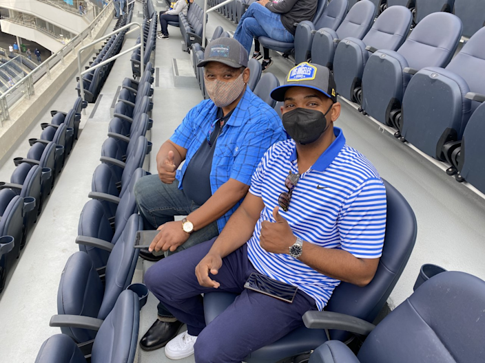 Rams fans Mark Bennett Sr. (Left) and son Mark Bennett Jr. at SoFi Stadium.