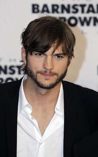 FILE - In this May 4, 2012 file photo, Ashton Kutcher arrives at the Barnstable Brown Derby party, in Louisville, Ky. Kutcher is one of several stars whose homes have been targeted by pranksters who place fake 911 calls to try to draw out large police responses in a hoax known as swatting. A 12-year-old boy was arrested in December for placing a fake 911call claiming multiple people were shot at Kutcher's home on Oct. 3, 2012. (AP Photo/Darron Cummings, File)