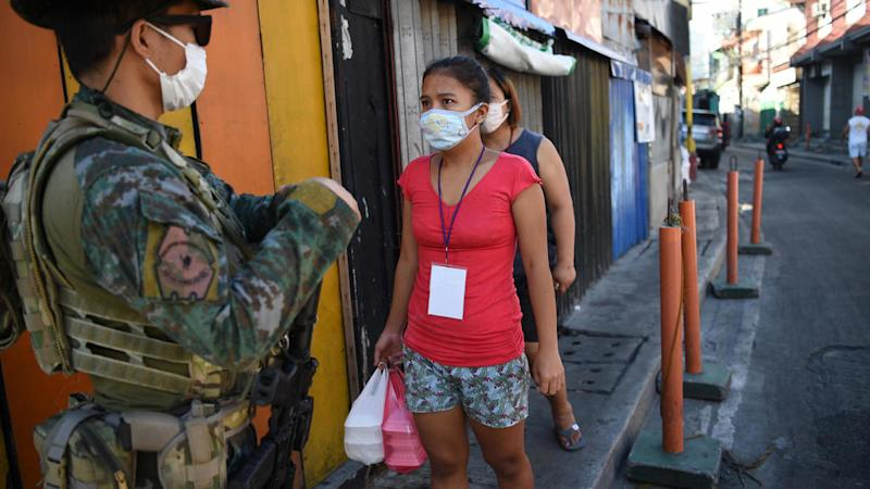 Millions back under lockdown in Philippines amid surge in coronavirus cases