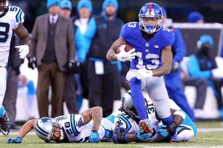 Dec 20, 2015; East Rutherford, NJ, USA; New York Giants wide receiver Odell Beckham Jr. (13) runs the ball past Carolina Panthers cornerback Cortland Finnegan (26) and defensive back Charles Tillman (31) during the fourth quarter at MetLife Stadium. Mandatory Credit: Brad Penner-USA TODAY Sports