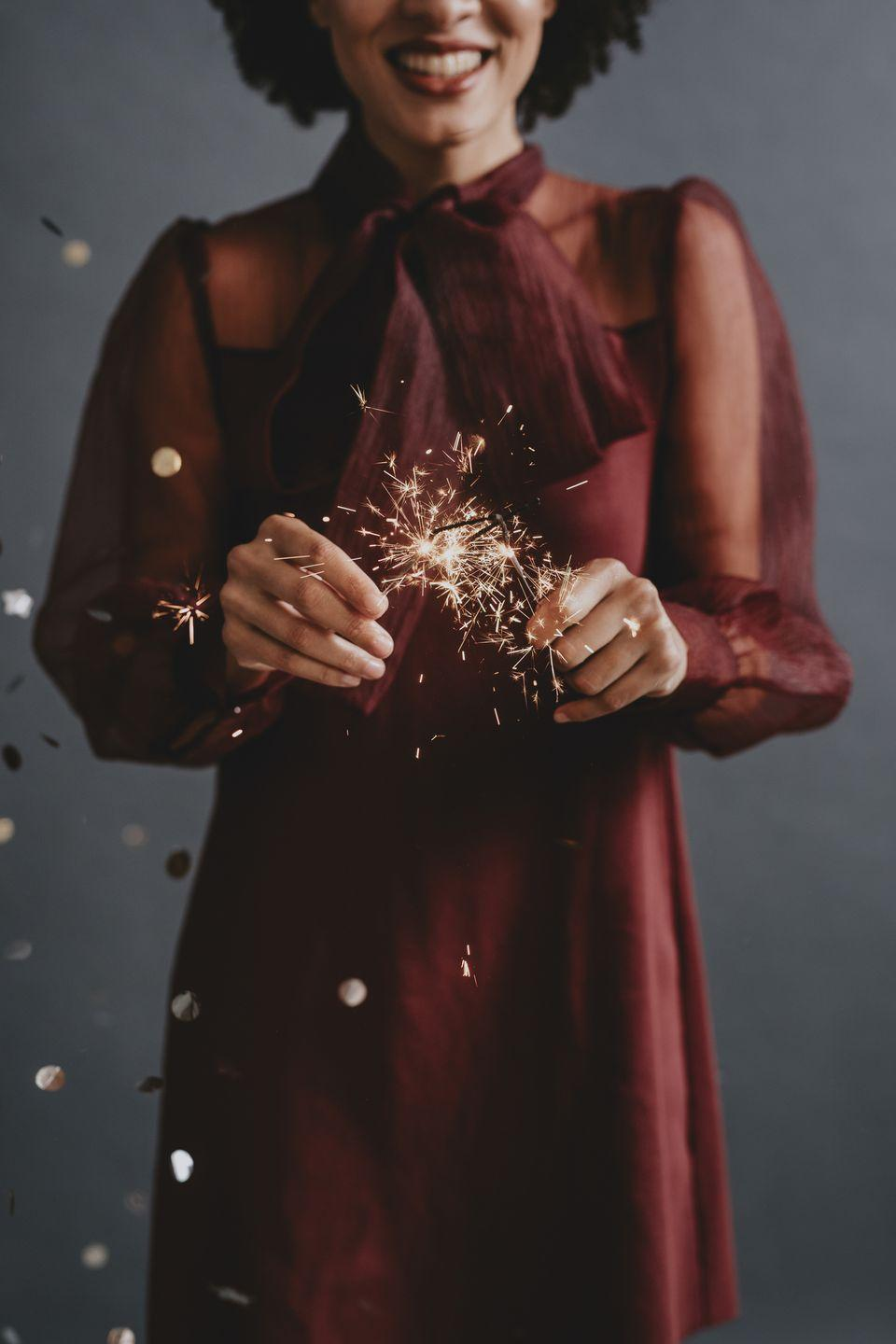 "<p>Just because you're staying home doesn't mean you have to wear your PJs (although if you want to, you should!). Throw on your favorite holiday dress and some bold New Year's Eve makeup. Who cares if the only one who sees it is the cat?</p><p><strong>RELATED: </strong><a href=""https://www.goodhousekeeping.com/beauty/fashion/g25400387/new-years-eve-outfits/"" rel=""nofollow noopener"" target=""_blank"" data-ylk=""slk:20 Affordable New Year's Eve Outfits to Ring in 2021 in Style"" class=""link rapid-noclick-resp"">20 Affordable New Year's Eve Outfits to Ring in 2021 in Style</a></p>"
