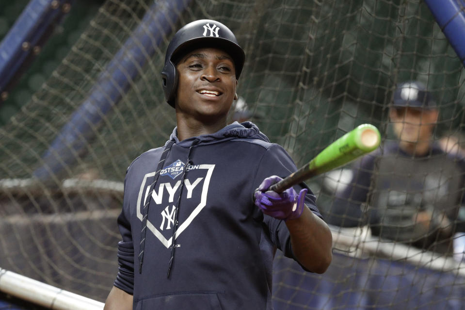 New York Yankees shortstop Didi Gregorius jokes with teammates during batting practice for a baseball American League Championship Series in Houston, Friday, Oct. 11, 2019. The Yankees are scheduled to face the Houston Astros starting Saturday. (AP Photo/Eric Gay)