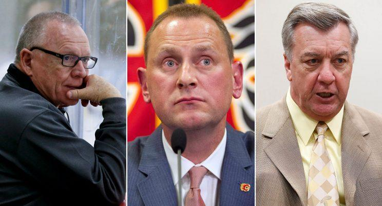 Penguins GM Jim Rutherford (left), Flames GM Brad Treliving (centre) and former Thrashers GM Don Waddell (right)... (AP/CP Photos)