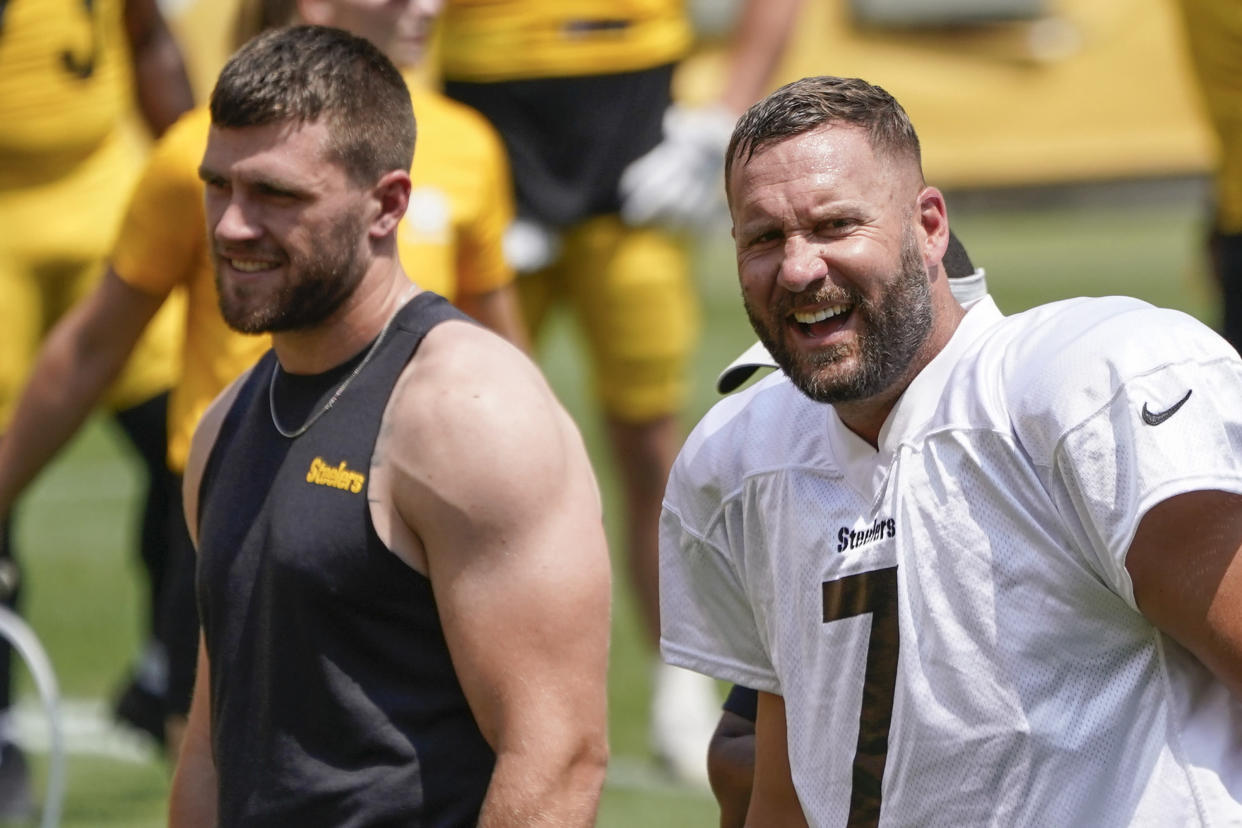 Pittsburgh Steelers outside linebacker T.J. Watt, left, and quarterback Ben Roethlisberger (7) react as they watch one-on-one blocking drills between linebackers and running backs at NFL football practice, Wednesday, July 28, 2021, in Pittsburgh. (AP Photo/Keith Srakocic)
