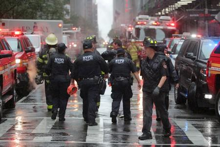 FILE PHOTO: Emergency services first responders arrive at 787 7th Avenue in midtown Manhattan where helicopter crashed in New York