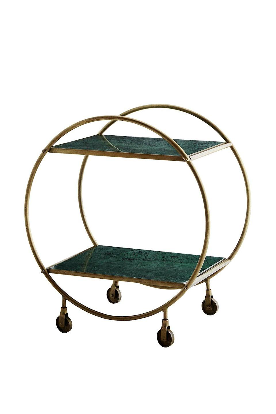 """<p><strong>All that jazz</strong></p><p>A cocktail of trends all in one, this green marble and brass round drinks trolley will transform your home bar into something out of an F. Scott Fitzgerald novel. Highball, anyone?</p><p>£340, <a href=""""http://www.rockettstgeorge.co.uk/round-brass-and-marble-drinks-trolley-in-green-44633-p.html"""" rel=""""nofollow noopener"""" target=""""_blank"""" data-ylk=""""slk:rocketstgeorge.co.uk"""" class=""""link rapid-noclick-resp"""">rocketstgeorge.co.uk</a></p>"""