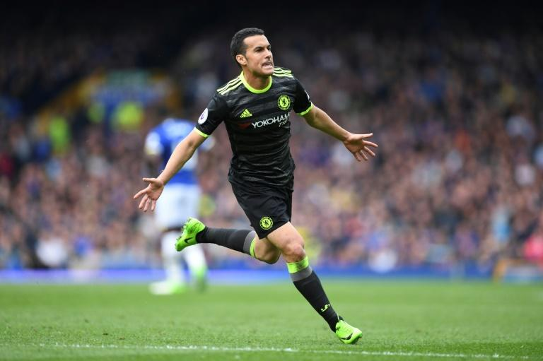 Chelsea's Spanish midfielder Pedro celebrates scores the opening goal during the English Premier League match against Everton at Goodison Park in Liverpool on April 30, 2017