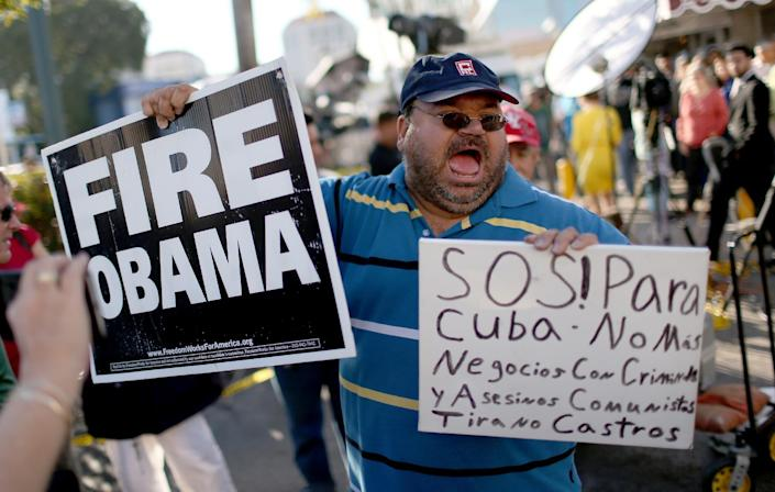 Cuban-Americans living in Miami -- a hotbed of angry opposition to the Castro regime -- expressed dismay at the news that US President Barack Obama wants to normalize relations with Havana (AFP Photo/Joe Raedle)
