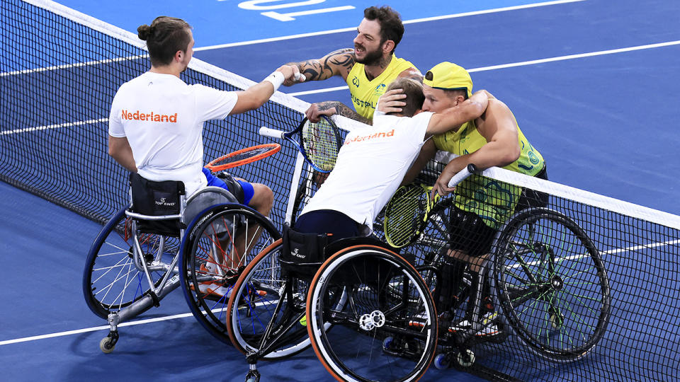Sam Schroder and Niels Vink, pictured here embracing Dylan Alcott and Heath Davidson at the net.