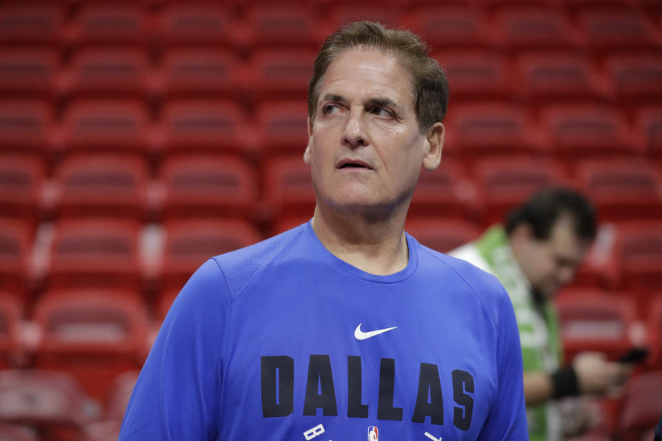 Dallas Mavericks owner Mark Cuban watches players warm up before the start of an NBA basketball game against the Miami Heat, Friday, Feb. 28, 2020, in Miami. (AP Photo/Wilfredo Lee)