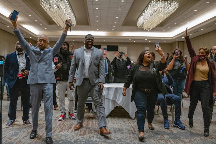 As Hennepin County Judge Peter Cahill read the final guilty verdict in the trial of former Minneapolis police officer Derek Chauvin, George Floyd's family, close friends and advisors who gathered in Minneapolis on April 20 to watch the verdict in semi private transitioned from cries to cheers. From left in front row: the Rev. Al Sharpton; Brandon Williams, a nephew who Floyd thought of like a son; Williams's longtime girlfriend Tiffany Hall, who knew Floyd for 16 years; and Rachel Noerdlinger, in the red coat, who works with Sharpton's National Action Network.