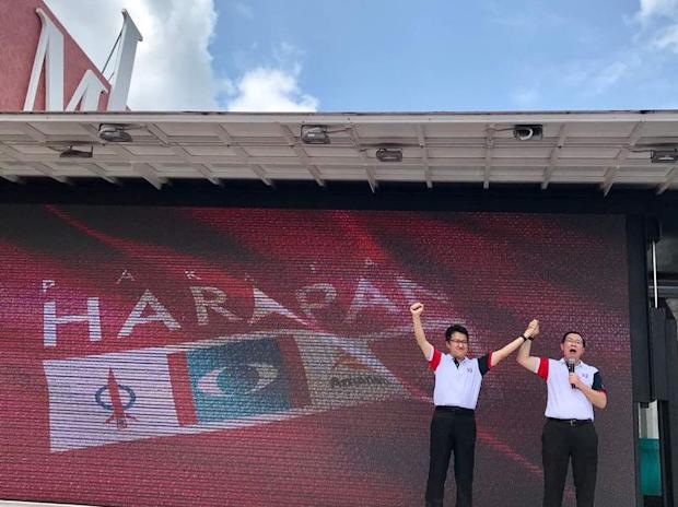 Johor DAP chief Liew Chin Tong (left) has been announced as Pakatan Harapan's (PH) Ayer Hitam parliament candidate during DAP's 52nd anniversary event held at the Ayer Hitam PH election centre in Bandar Baru in Ayer Hitam, March 18, 2018. — Picture by Ben Tan