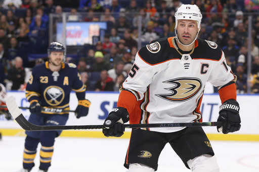 FILE - Anaheim Ducks forward Ryan Getzlaf (15) skates during the first period of an NHL hockey game against the Buffalo Sabres in Buffalo, in this Sunday, Feb. 9, 2020, file photo. Captain Ryan Getzlaf is back along with goalie John Gibson and much of the same veteran core that struggled last season.(AP Photo/Jeffrey T. Barnes, File)