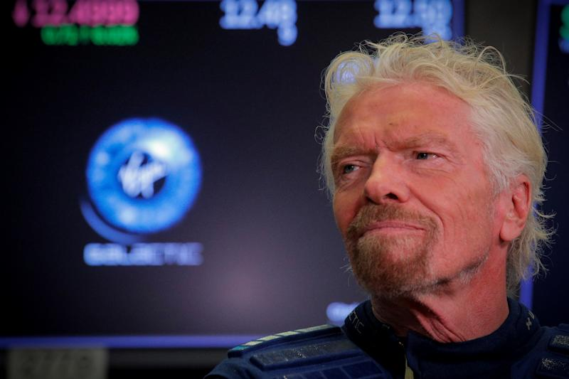 Sir Richard Branson stands on the floor of the New York Stock Exchange (NYSE) ahead of Virgin Galactic (SPCE) trading in New York, U.S., October 28, 2019. REUTERS/Brendan McDermid
