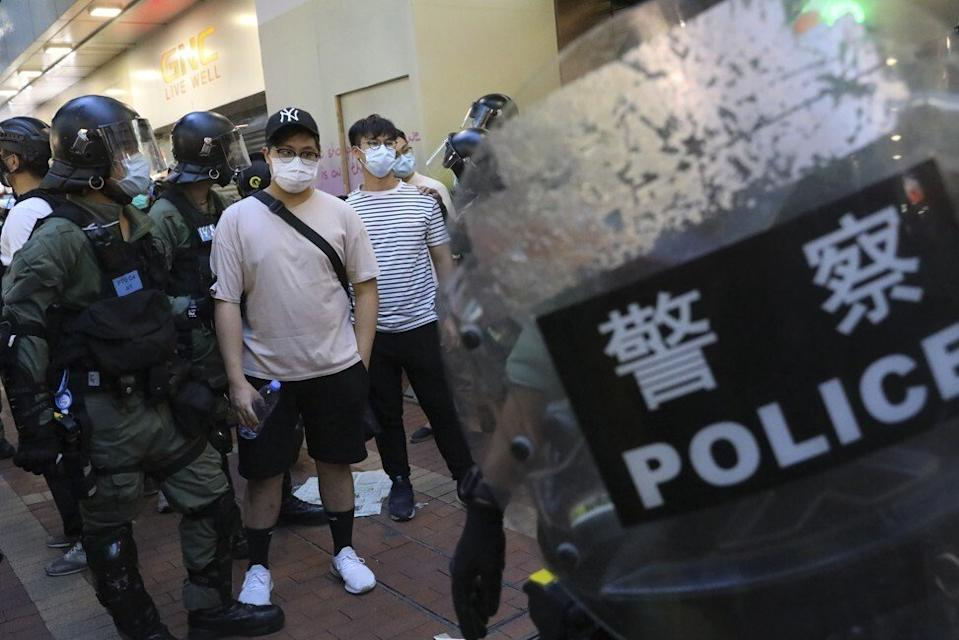 Police carry out stop-and-search operations in Mong Kok as protesters respond to online calls in September to join an anti-government rally. Photo: Dickson Lee