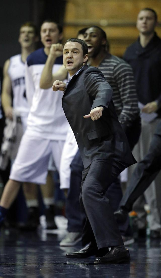 Butler head coach Brandon Miller reacts to a play during the first half of an NCAA college basketball game against Vanderbilt Tuesday, Nov. 19, 2013, in Indianapolis. (AP Photo/Darron Cummings)