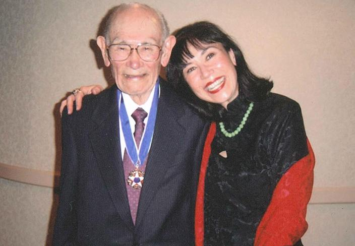 Karen Korematsu poses with her father, the late civil rights icon Fred Korematsu, after he was awarded the Presidential Medal of Freedom from then-President Bill Clinton in 1998. (Photo by Shirley Nakao, courtesy of the Fred T. Korematsu Institute)