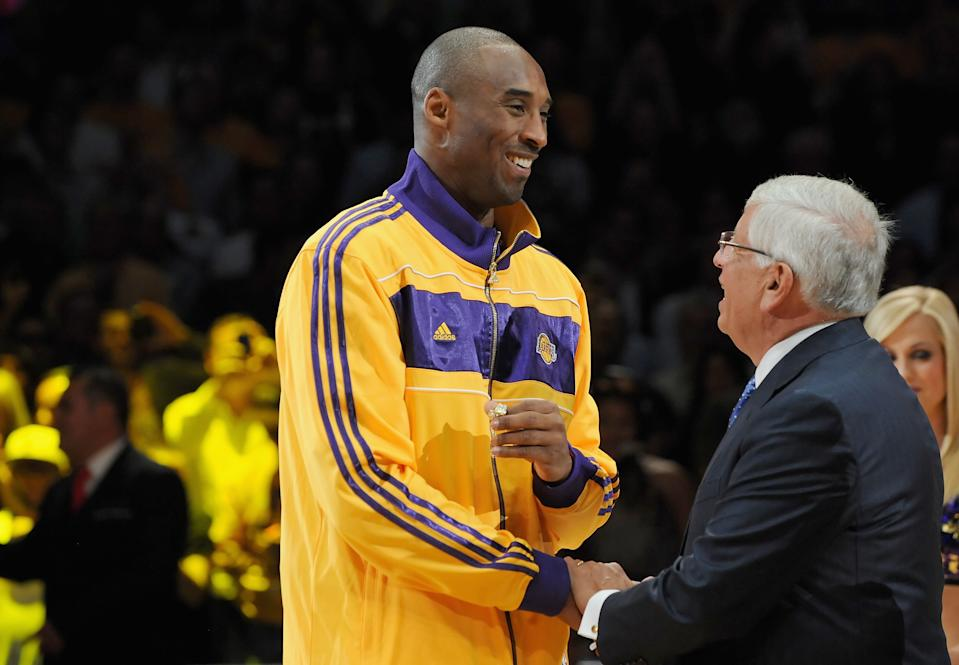 Kobe Bryant #24 of the Los Angeles Lakers receives his championship ring from NBA commissioner David Stern.
