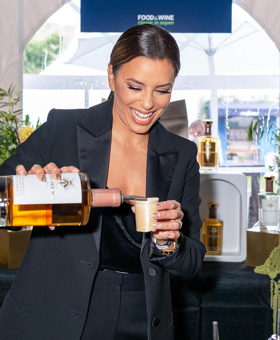<p>Eva Longoria pours a shot of her Casa Del Sol tequila at the Food & Wine Classic in Aspen on Sept. 12.</p>