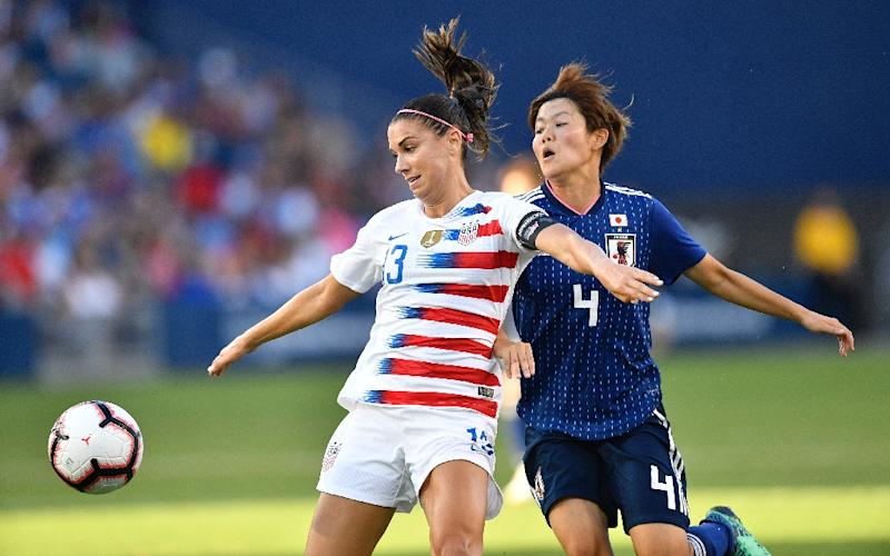e043e0cf1c3 Alex Morgan of USA (L) fights for the ball with Japan  39
