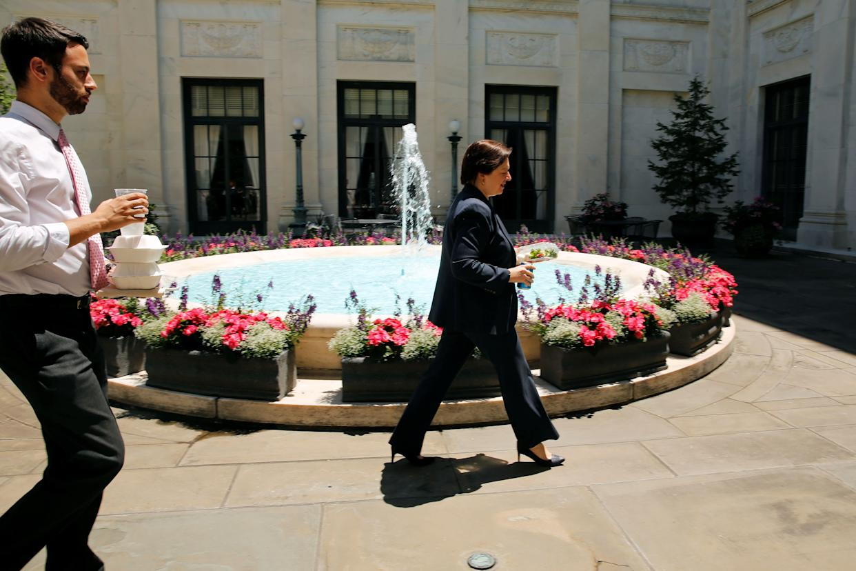 U.S. Supreme Court Justice Elena Kagan walks with her clerks in one of the four inner courtyards at the Supreme Court building in Washington, U.S. June 20, 2016.