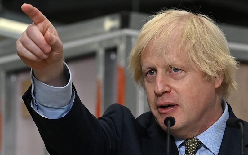 Britain's Prime Minister Boris Johnson delivers a speech during his visit to Dudley College of Technology in Dudley - AFP