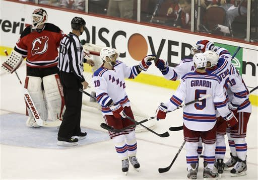 New York Rangers' Marian Gaborik (10), of Slovakia, celebrates with teammates after Ruslan Fedotenko, second from right, of Ukraine, scored past New Jersey Devils' Martin Brodeur during the second period of Game 6 of the NHL hockey Stanley Cup Eastern Conference finals, Friday, May 25, 2012, in Newark, N.J. (AP Photo/Frank Franklin II)