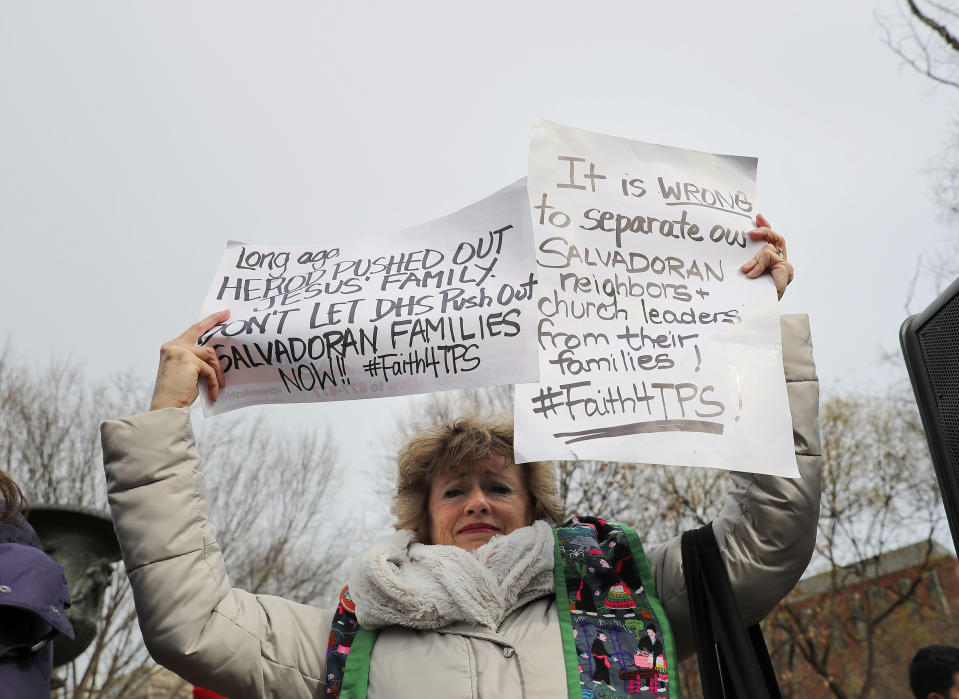 <p>Rev. Sharon Stanley-Rea holds up hand-made signs as she joins CASA de Maryland, an immigration advocacy and assistance organization, during rally in Lafayette Park, across from the White House in Washington, Monday, Jan. 8, 2018, in reaction to the announcement regarding Temporary Protective Status for people from El Salvador. (Photo: Pablo Martinez Monsivais/AP) </p>