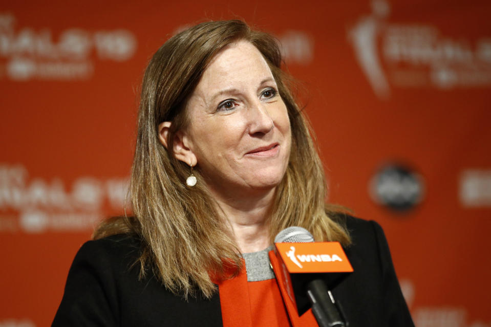 FILE - In this Sept. 29, 2019, file photo, WNBA Commissioner Cathy Engelbert speaks at a news conference in Washington. WNBA rookies will start receiving health benefits beginning Friday, May 1, 2020. Given the unique nature of this crisis, rookies and other new players currently under contract will receive full health benefits beginning on May 1, while veterans, who already receive year-round health benefits, will not have any break in their coverage, WNBA Commissioner Engelbert told The Associated Press. (AP Photo/Patrick Semansky, File)