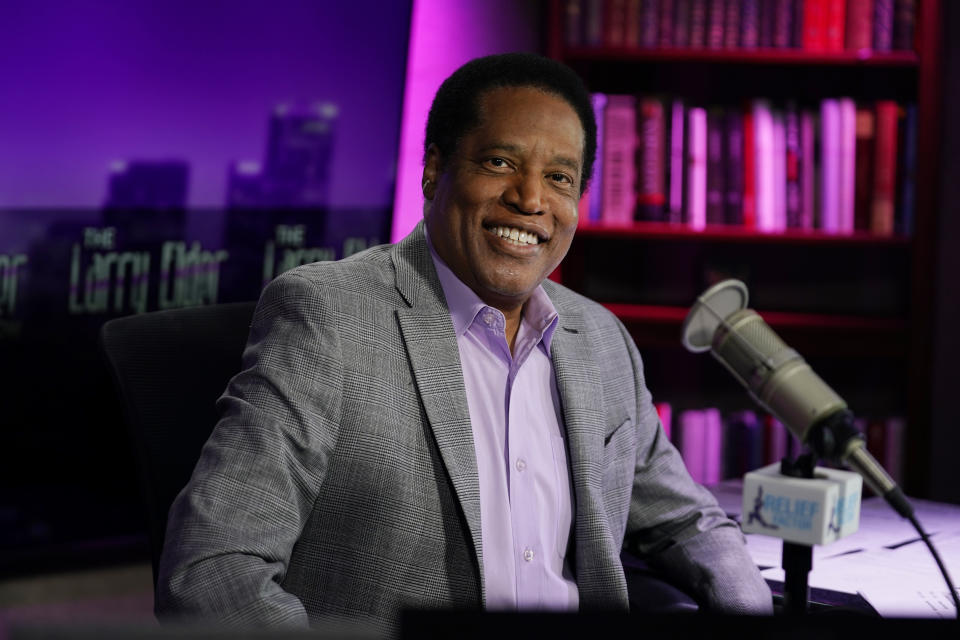 FILE - In this July 12, 2021 file photo, radio talk show host Larry Elder poses for a photo in his studio in Burbank, Calif. Elder, the leading Republican candidate in the California recall election that could remove Democratic Gov. Gavin Newsom from office, reported income of over $100,000 in the last year from business interests that included media and film companies and a string of speeches to Republican and conservative groups, documents showed Tuesday, Aug. 17, 2021. (AP Photo/Marcio Jose Sanchez, File)