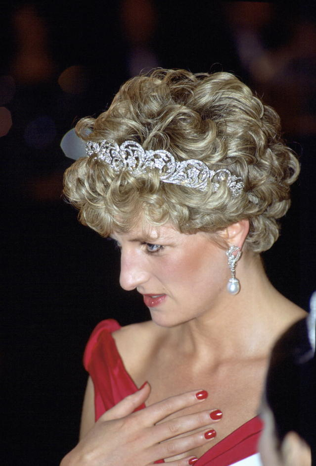 <p>After her marriage, Diana grew her nails a bit longer as her style matured and became known for wearing bright red polish. While commonplace now, red nails were long considered a bit unladylike. But Diana often challenged and changed the rules. (Photo: Tim Graham/Getty Images) </p>