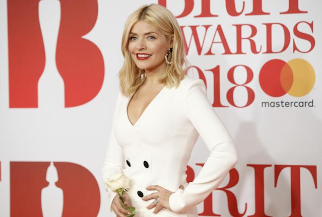 Holly Willoughby has questioned the success of the #TimesUp movement after paparazzi took pictures up her skirt at the Brits .(Photo: Getty)