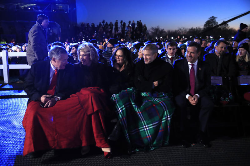 Rep. Mark Meadows, R-N.C., left, Rep. Jim Jordan, R-Ohio, second from right, and Rep. Devin Nunes, R-Calif., right, wait for President Donald Trump and first lady Melania Trump attend the National Christmas Tree lighting ceremony at the Ellipse near the White House in Washington, Thursday, Dec. 5, 2019. (AP Photo/Manuel Balce Ceneta)