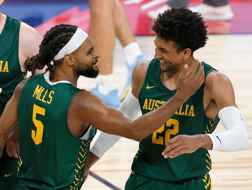Patty Mills and Matisse Thybulle, here celebrating an exhibition win for Australia are two of a plethora of NBA players suiting up to play at the Tokyo Olympics.