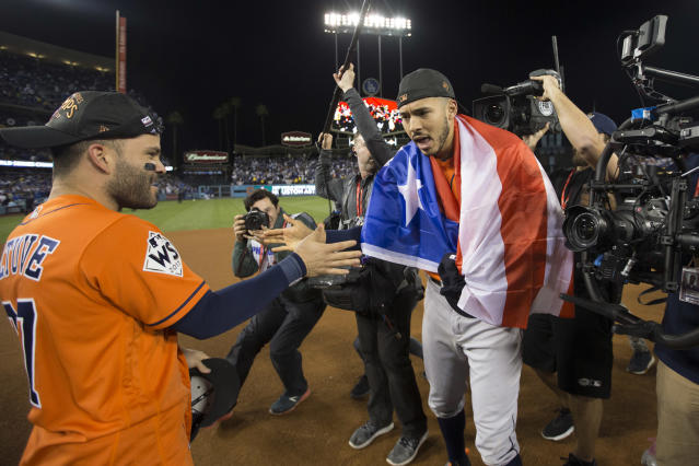 <p>Jose Altuve #27 and Carlos Correa #1 of the Houston Astros celebrate on the field after the Astros defeated the Los Angeles Dodgers in Game 7 of the 2017 World Series at Dodger Stadium on Wednesday, November 1, 2017 in Los Angeles, California. (Photo by Rob Tringali/MLB Photos via Getty Images) </p>