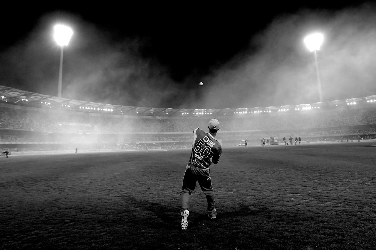 BRISBANE, AUSTRALIA - JANUARY 07:  (EDITORS NOTE: Images has been converted to Black and White.) Chris Lynn of the Heat fields during the interval of the Big Bash League match between the Brisbane Heat and the Sydney Sixers at The Gabba on January 7, 2013 in Brisbane, Australia.  (Photo by Chris Hyde/Getty Images)