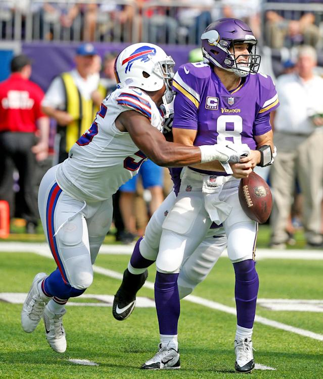 <p>Minnesota Vikings quarterback Kirk Cousins (8) fumbles as he is hit by Buffalo Bills defensive end Jerry Hughes, left, during the first half of an NFL football game, Sunday, Sept. 23, 2018, in Minneapolis. (AP Photo/Bruce Kluckhohn) </p>