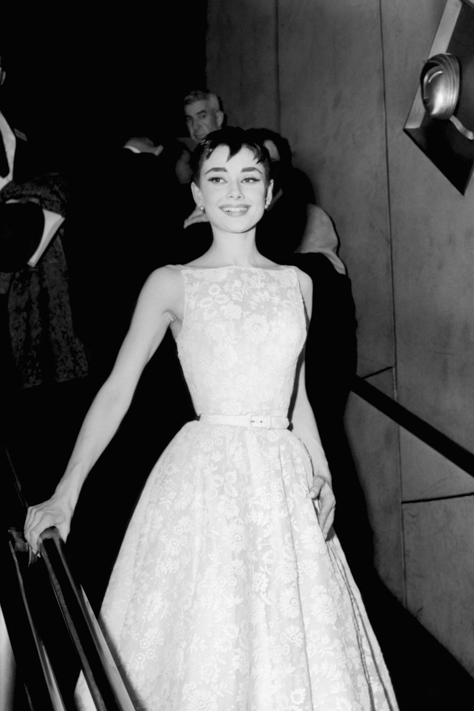 """<h2>Audrey Hepburn, 1954<br></h2><br>It never took much to make the late Audrey Hepburn look glamorous, but in this Givenchy gown, Hepburn, glowing from winning an Oscar for <em>Roman Holiday</em>, is nothing short of perfection.<br><br><em>Audrey Hepburn in Givenchy.</em><span class=""""copyright"""">Photo: NBCU Photo Bank/Getty Images. </span>"""